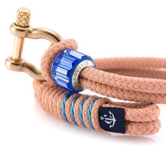 Женский красный браслет с синим камнем и золотистым замком — SWAROVSKI 7249